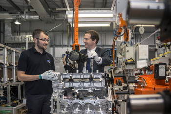 Engine assembly technician Ashley Baldwin shows George Osborne the processes of manufacture