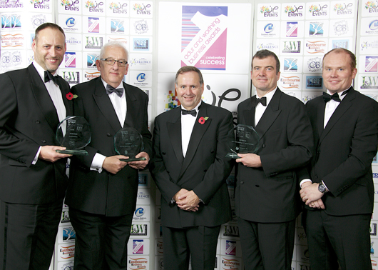 L-R: Dan hall and Andrew Swayne (Ricardo), Peter Webb MBE (MD of award sponsor ETI Ltd), Jason march and Martin Starkey (Ricardo)