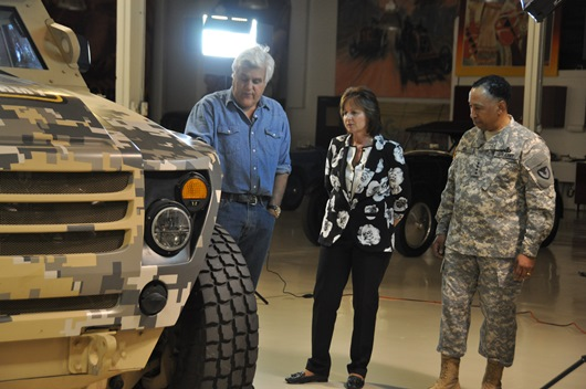 Jay Leno is shown the Ricardo-engineered FED vehicle by Gen. Dennis L. Via, commanding general of Army Materiel Command (AMC), and Grace Bochenek, Ph.D., AMC's chief technology officer