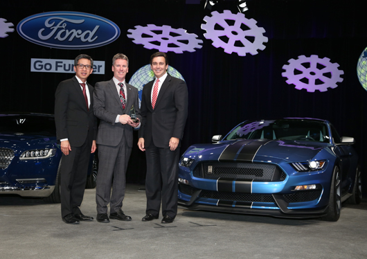 Ricardo CEO Dave Shemmans (centre) receives the Gold World Excellence Award from Hau Thai-Tang, Ford Group Vice President, Global Purchasing (Left) and Mark Fields, Ford Motor Company President and CEO (right)