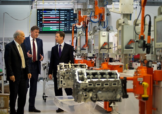 Ricardo UK managing director Martin Fausset (centre) explains the McLaren engine production line to Nick Clegg (right) and Vince Cable (left)