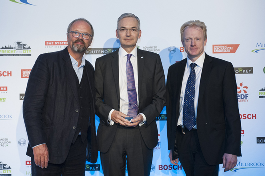Professor Neville Jackson receives the award for 'Outstanding individual in promoting low carbon transport' from Master of Ceremonies Robert Llewellyn (left) and Chairman of the LowCVP Darren Messem (right)