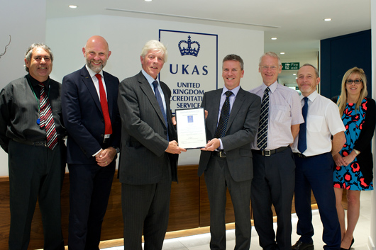 Left-Right:  Alan Web, assessment manager, UKAS; Paul Seller, MD Ricardo Rail; Lord Lindsay, UKAS chairman; Dave Shemmans, CEO Ricardo plc; Andrew Ross, accreditation manager, UKAS; Richard Gibney, director, Ricardo Certification; Michelle Marsh, overseas co-ordinator, UKAS