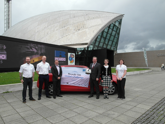 Drivers of the first leg since the UK return of the Ricardo100 Global Challenge Scott Hamilton (far left) and Susannah Telfer (far right), together with (left to right) Corin Wren, Chief Executive of the Glasgow Science Centre Stephen Breslin, Colin McNaught, and Katrin McNaught, at yesterday's event
