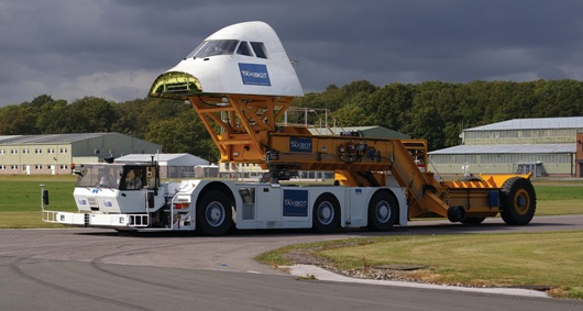 The IAI TaxiBot demonstrator vehicle designed and built by Ricardo, shown coupled to its Ricardo designed hydrostatic dynamometer equipped test trailer capable of simulating the taxiing performance of a large passenger aircraft