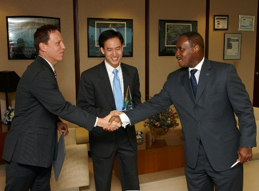 Vice president of Ford Customer Service Division Frederick Toney congratulates Kevin Hauser (left) and Andy Chien