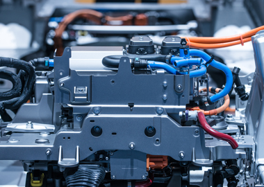 Commercial vehicle hybrid powertrain cost reduction through make versus buy evaluation